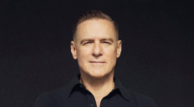 Singer Bryan Adams is releasing a photography book of candid portraits of Big Issue vendors (Bryan Adams/PA)