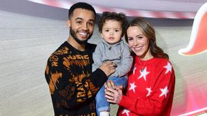 Aston Merrygold and fiancee Sarah with their son Grayson (Ian West/PA)