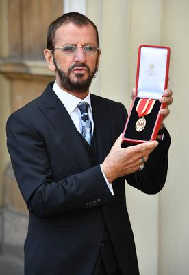 Sir Ringo Starr was knighted for services to music (John Stillwell/PA)