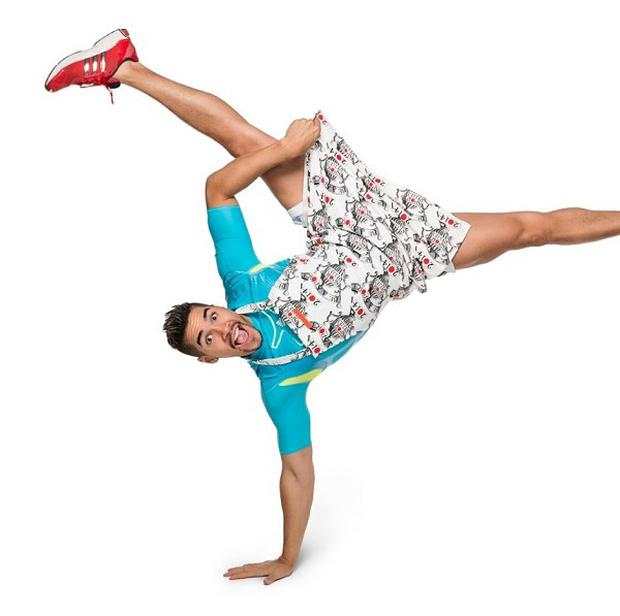 Louis Smith poses in an apron for Sport Relief