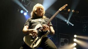 Status Quo's Rick Parfitt on stage at Wembley Arena in 2006