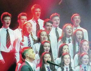 YouTube images of the choirs on stage with Gary Barlow