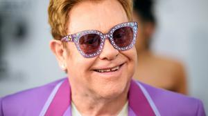 Sir Elton John said he had been playing snakes and ladders while staying in (Matt Crossick/PA)