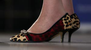 Theresa May said it was interesting that people focused on her shoes, claiming male counterparts were not subjected to the same scrutiny