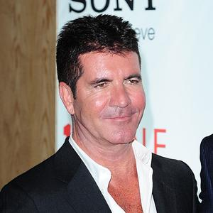 Simon Cowell is enjoying being a new dad
