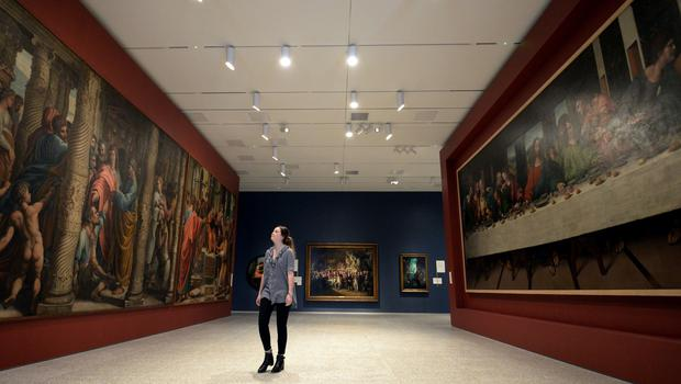 A visitor looks at works by Sir James Thornhill (left), copies of paintings by Raphael, and a copy of Leonardo da Vinci's The Last Supper (right), at the launch of the new Royal Academy (Kirsty O'Connor/PA)