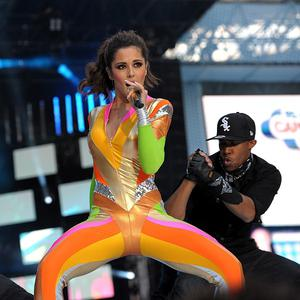 Cheryl Cole performing with her boyfriend and dancer Tre Holloway, right