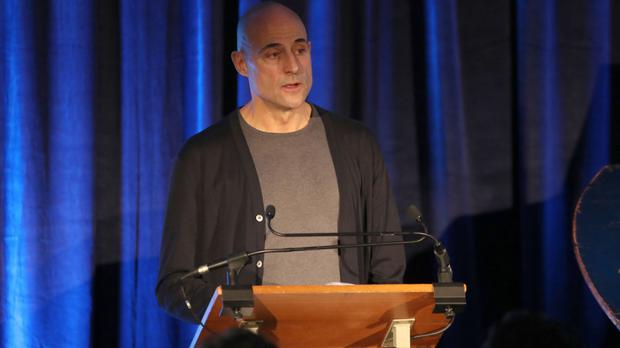 Mark Strong reads to the audience at HMP Brixton