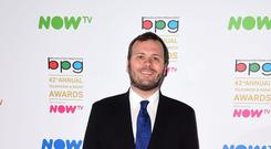 John Finnemore picked up the outstanding contribution to writing award (Ian West/PA)