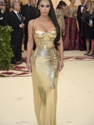 Kim Kardashian-West wore a gold Versace gown for the Met Gala (Evan Agostini/Invision/AP)