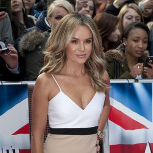 Britain's Got Talent judge Amanda Holden confessed she got a thrill out of hitting her golden buzzer