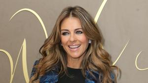 Liz Hurley has not ruled out taking a leaf out of co-star Dame Joan Collins's book and dating a much younger man