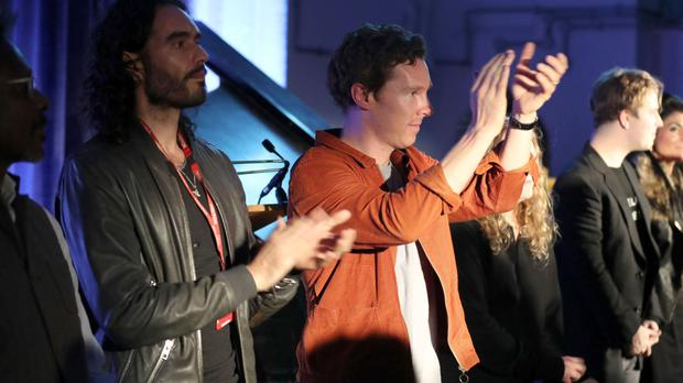 Russell Brand and Benedict Cumberbatch join fellow performers to applaud the crowd after Letters Live at HMP Brixton