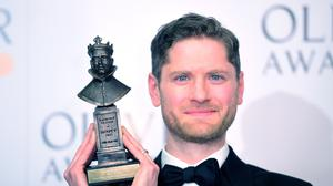Kyle Soller with the Best actor award, in The Inheritance, presented by Sally Field and Bill Pullman at the Olivier Awards at the Royal Albert Hall in London. (Ian West/PA)