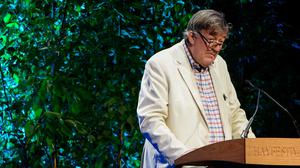 Stephen Fry is teaching visitors to the UK about local customs