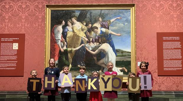 Children stand in front of The Finding Of Moses by Orazio Gentileschi (National Gallery/PA)
