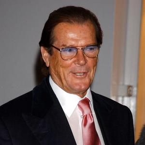 Sir Roger Moore and Joan Collins were among the guests