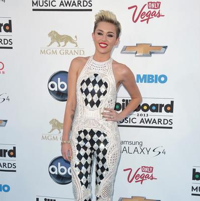 Miley Cyrus has teased fans with a picture of her apparently wearing a wedding dress