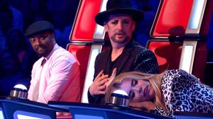 Paloma Faith pretends to fall asleep during a pitch by Boy George for a contestant