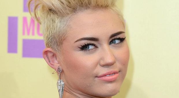 Miley Cyrus says Liam Hemsworth loves her new look