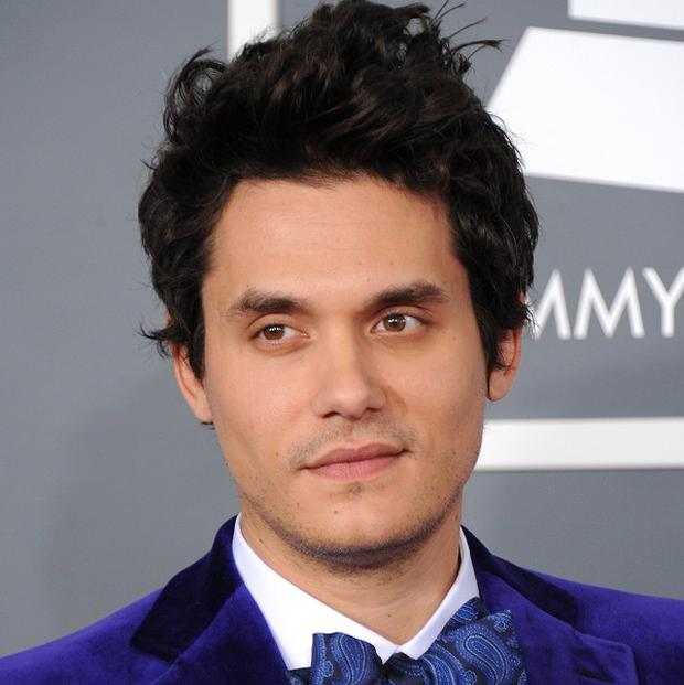 John Mayer arrives at the 55th annual Grammy Awards on Sunday, Feb. 10, 2013, in Los Angeles. (Photo by Jordan Strauss/Invision/AP)
