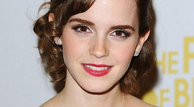 Emma Watson says she understands why people are fascinated by Kristen Stewart and Robert Pattinson