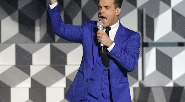 Robbie Williams likes to travel with his pet pooches