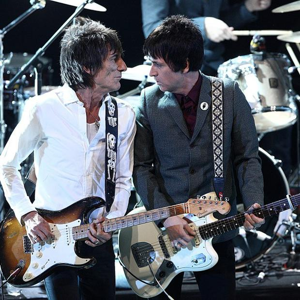 Johnny Marr, right, performs on stage with Ronnie Wood during the NME awards