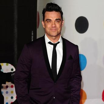 File photo dated 20/2/2013 of Robbie Williams who has shown off the first fruits of his return to working with Guy Chambers with an expletive-fuelled track in which he branded the Brit Awards