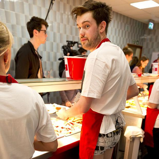 Free for editorial use until 16th March 2013 Comic Relief handout photo of Fresh Meat cast member Jack Whitehall serve students breakfast at Newcastle Universitys biggest halls, Castle Leazes as they make their way around seven different universities onboard the 'banter bus' with the aim of raising as much money as they can for Red Nose Day. PRESS ASSOCIATION Photo. Picture date: Friday March 1, 2013. Photo credit should read: Tom Dymond/Comic Relief/PA Wire NOTE TO EDITORS: This handout photo may only be used in for editorial reporting purposes for the contemporaneous illustration of events, things or the people in the image or facts mentioned in the caption. Reuse of the picture may require further permission from the copyright holder.
