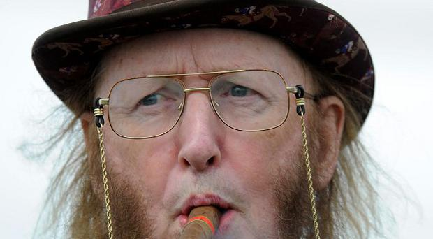 John McCririck is resting in hospital after falling ill