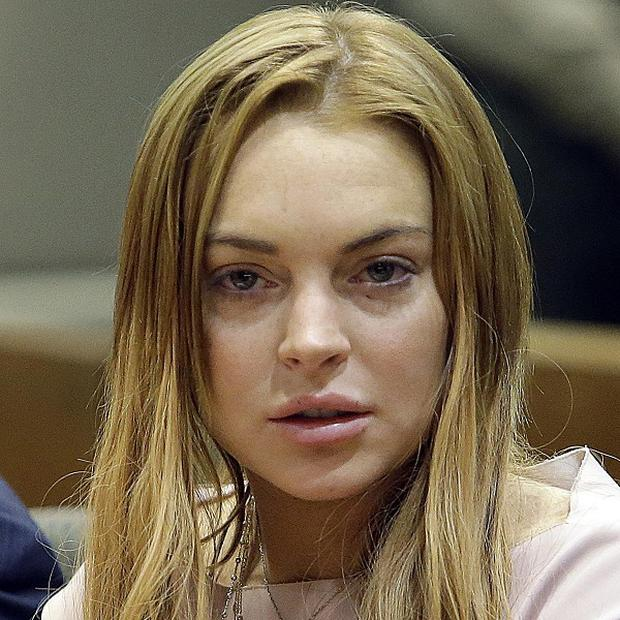 Lindsay Lohan faces no formal charges over an alleged assault at a nightclub (AP/Reed Saxon)