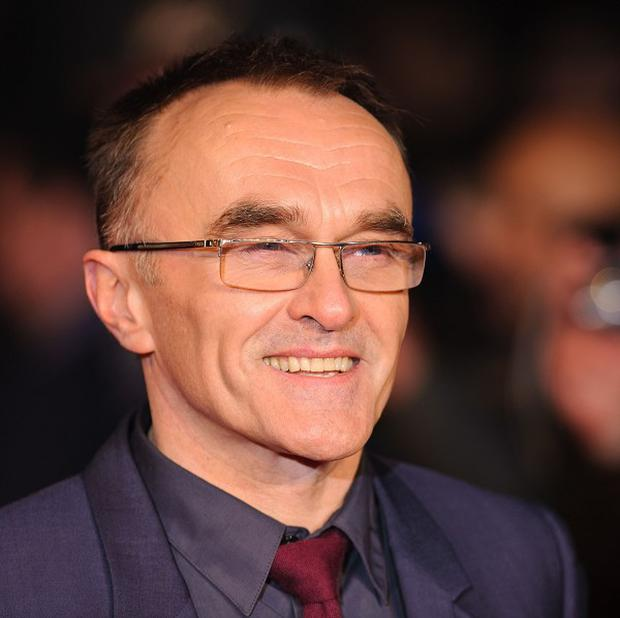 Danny Boyle has revealed that the Queen volunteered herself to star in the James Bond sketch for London 2012