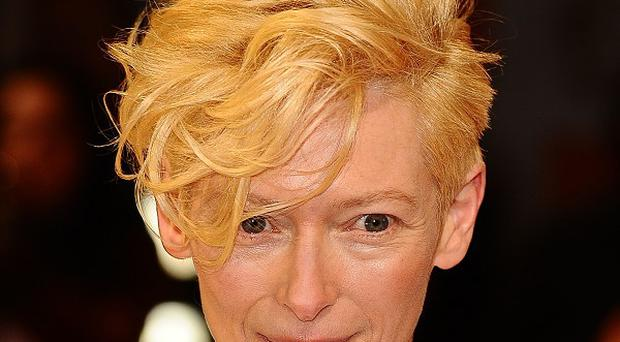 Tilda Swinton lies sleeping in a glass box for the day for her piece The Maybe