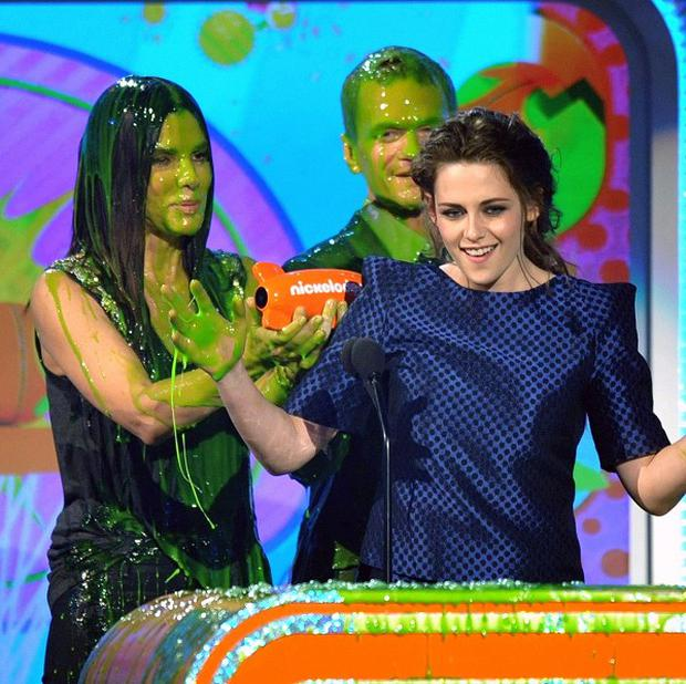 Kristen Stewart couldn't avoid the slime as she picked up her Kids' Choice gong
