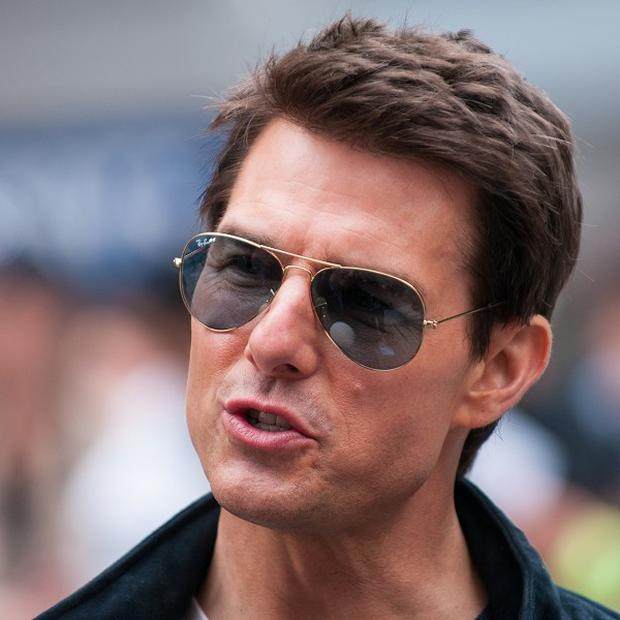 Tom Cruise was taking time off from promoting his new movie, Oblivion