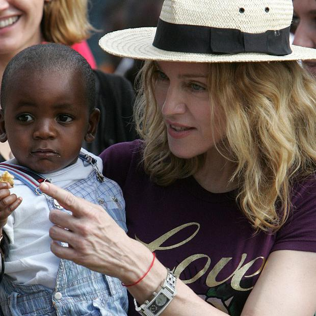 Madonna adopted son David Banda and daughter Mercy in Malawi