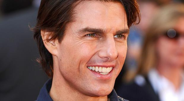 Tom Cruise says he fancies the idea of going into space