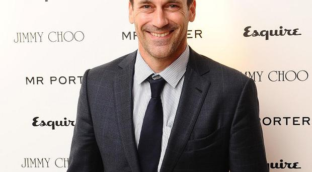 Jon Hamm said playing lothario Don Draper takes a 'psychic toll'