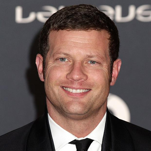 Host Dermot O'Leary greeted eager wannabes and posed for photographs at the London auditions