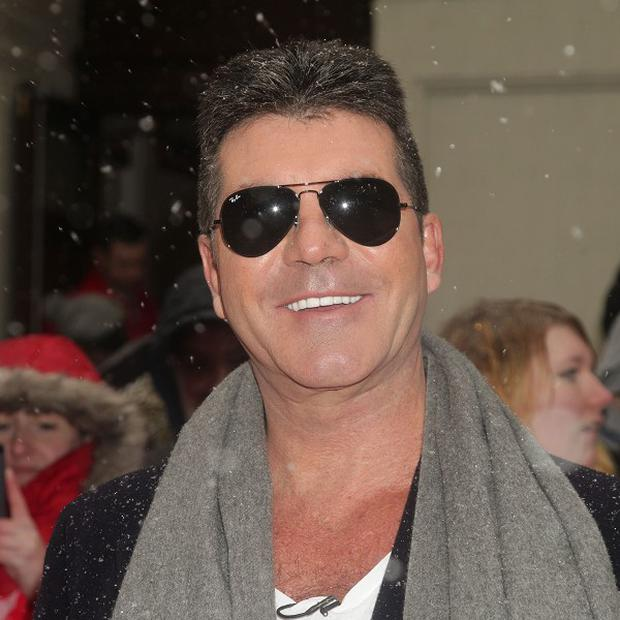 Simon Cowell said that he is happy being single