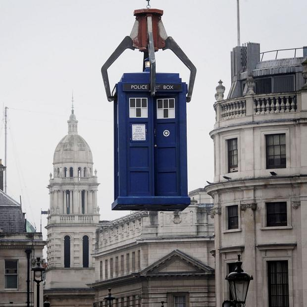 The Tardis is lowered into Trafalgar Square for the latest Doctor Who filming