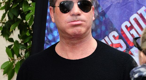 Simon Cowell said any TV scheduling clashes between Britain's Got Talent and The Voice were not his problem