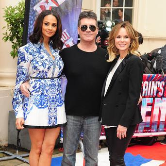 Alesha Dixon,Simon Cowell and Amanda Holden snuggle up on the red carpet at the Britain's Got Talent launch