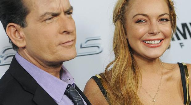 Charlie Sheen has been looking out for Lindsay Lohan