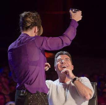 Amanda Holden threatens to pour water over Simon Cowell on Britain's Got Talent