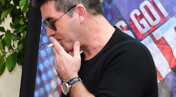 Simon Cowell has reportedly been trying to quit his smoking habit