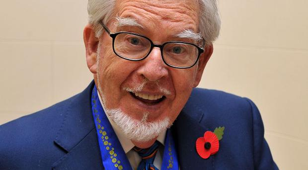 Rolf Harris' family are standing by him as they fight for his name to be cleared