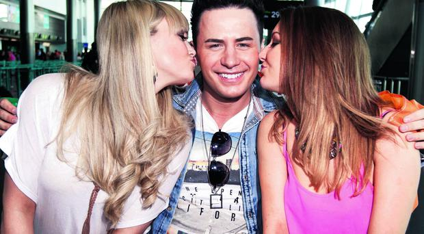 Irish Eurovision entry Ryan Dolan gets a kiss from (left) Leanne Moore and (right) Alison Vard Miller