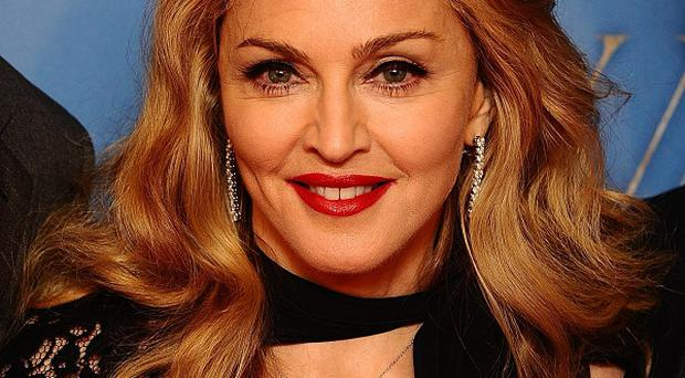 Madonna will use proceeds from a seven million US dollar art sale to help her charity